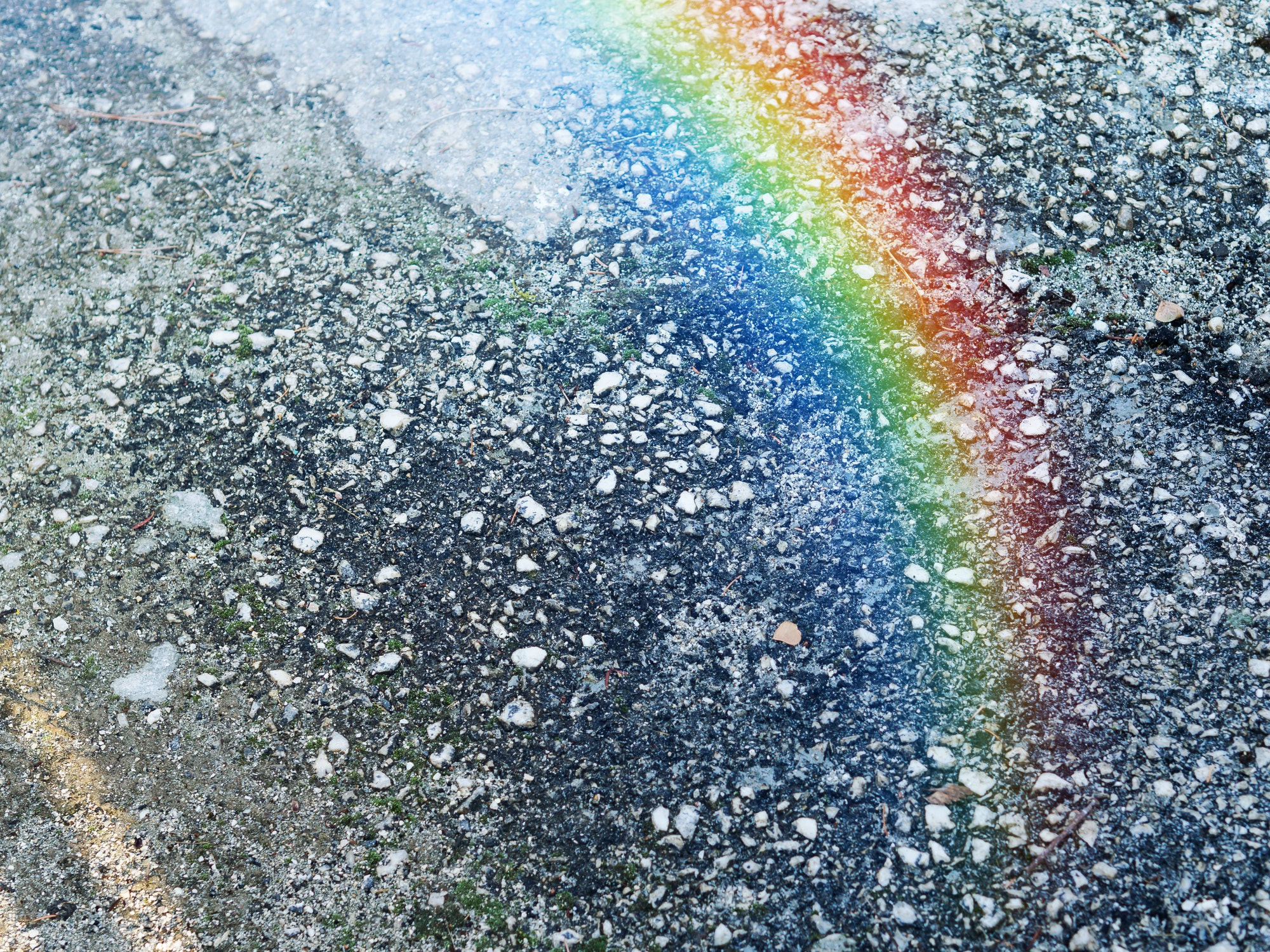 Stone ground background with rainbow light